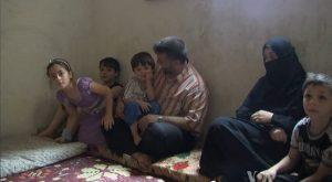 Syrische vluchtelingen in belastingkantoor. Foto: commons.wikimedia.org